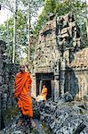 Cambodia, Siem Reap, Angkor Wat complex. monk inside Ta Nei temple (MR)