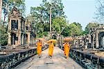 Cambodia, Siem Reap, Angkor Wat complex. Monks inside Preah Khan temple (MR)