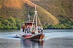 Indonesia, Loh Buaya, Rinca Island. A tourist boat sails off Rinca Island.