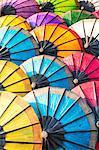 Laos, Luang Prabang. Colorful sa paper umbrellas for sale at the local market