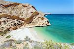 Oman, Muscat, Qantab. Rocky coastline and deserted beach, near Muscat