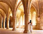 Portugal, Estremadura, Alcobaca, Santa Maria de Alcobaca Monastery, leaning on column in former dormitory (UNESCO World Heritage) (MR)