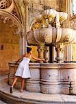 Portugal, Estremadura, Batalha, Monastery of Santa Maria da Vitoria, girl touching fountain (UNESCO World Heritage), (MR)