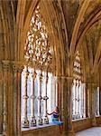 Portugal, Estremadura, Batalha, Monastery of Santa Maria da Vitoria; Woman sitting in cloisters (UNESCO World Heritage) (MR)