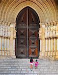 Portugal, Alentejo, Evora, Evora cathedral, girls walking up steps   (MR)