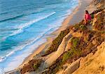 Portugal, Estramadura, Santa Cruz, woman sitting at lookout (MR)