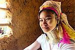 Thailand, Chiang Rai. Portrait of woman of Padaung (long neck) ethnicity (MR)