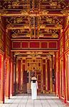 Woman wearing Ao Dai dress in Imperial Palace inside Citadel, Hue, Thua Thien-Hue, Vietnam (MR)