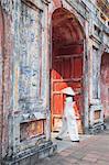 Woman wearing Ao Dai dress at Dien Tho inside Citadel, Hue, Thua Thien-Hue, Vietnam (MR)