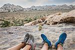 Hikers taking break on mountain, Joshua Tree National Park, California, US