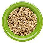 hemp seeds on an isolated green ceramic bowl