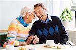 Loving senior couple laughing at nursing home