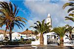 Village church Iglesia de San Martin and palm trees, San Bartolome, Lanzarote, Las Palmas, Canary Islands