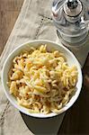 Butter Spätzle (soft egg noodles from Swabia) in a white porcelain bowl