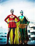 Superheroes standing on city rooftop