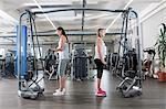 Two young women fitness studio sport practising
