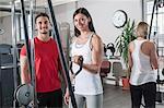 Fitness studio man two women sport healthy fit