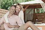Couple sitting summerhouse gazebo smiling happy