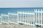 Blue wooden fence barrier beach Italy ocean