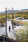Hiker walking through footbridge