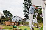 Senior man painting house