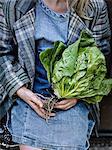 Girl holding lettuce