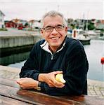 Smiling senior man at water