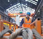 Portrait of steelworker in engineering factory