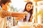 Children baking in kitchen