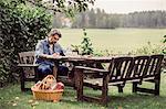 Mid adult man having breakfast at table in organic farm