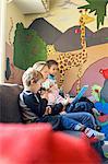 Teacher telling story to children in kindergarten