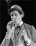 1910s 1920s CHARACTER MAN INHALING CIGAR CON MAN BOWLER HAT FANCY SUIT CRAVAT