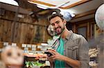Man using smartphone in health food store