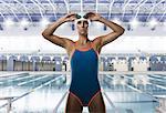 Female swimmer adjusting swimming goggles