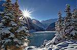 Sun rises above mountain lake, winter