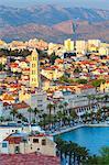 Elevated view over Split's picturesque Stari Grad and harbour illuminated at sunset, Split, Dalmatia, Croatia, Europe