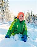 Boy playing at winter