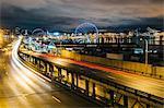 Road to port and ferris wheel, Seattle, Washington, USA