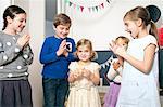 Children on birthday party having fun, Munich, Bavaria, Germany