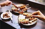 People eating Japanese style Yakitori