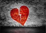 Shape of broken heart on murky brick wall