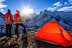 Women watching sunrise in Himalayas
