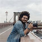 Photographer on Brooklyn Bridge