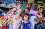 Family taking smartphone selfie at amusement park