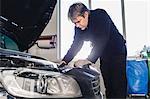 Mechanic repairing car in auto repair shop