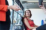 Three businesswomen sharing informal meeting at office desk