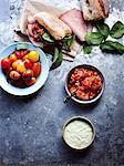 Still life of ham and bread with tomato chilli jam