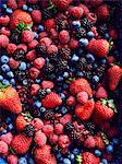 Still life with abundance of strawberries, blackberries, blueberries, raspberries and cranberries