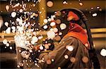 Sparks and worker using grinder