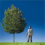 businessman watering a tree